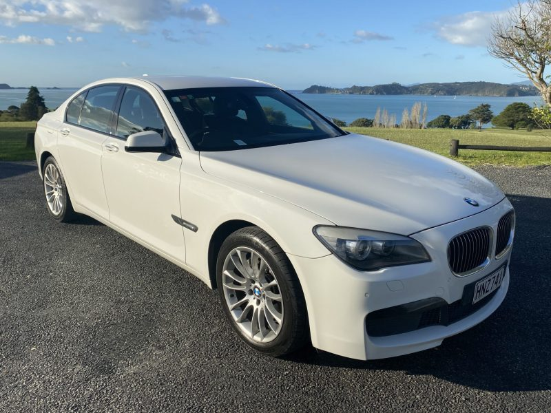 BMW 7 Series with Bay of Islands in the background