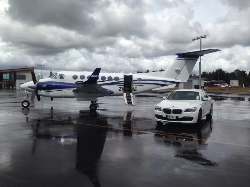 Private Jet with Black Robin BMW parked alongside