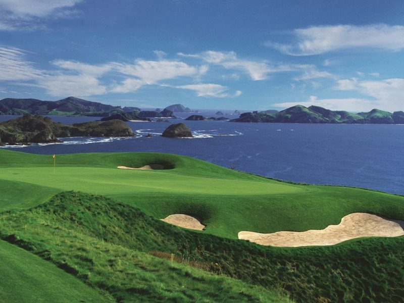 Stunning water views from the greens at Kauri Cliffs Golf Course, Northland